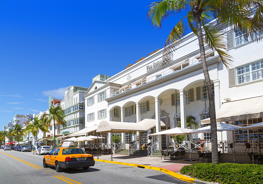 Ocean Drive and Art Deco architecture and yellow cab, Miami Beach, Miami, Florida, United States of America, North America