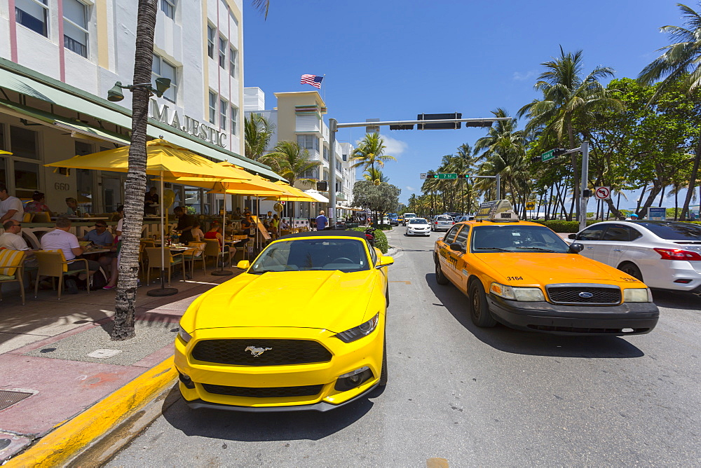 Ocean Drive, yellow cars and Art Deco architecture, Miami Beach, Miami, Florida, United States of America, North America