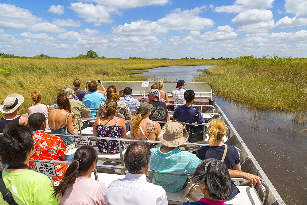 Tourists onboard airboat in the Everglades Safari Park, Miami, Florida, United States of America, North America