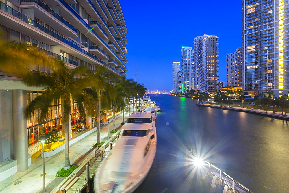 City skyscrapers and Miami River at dusk in Downtown Miami, Miami, Florida, United States of America, North America
