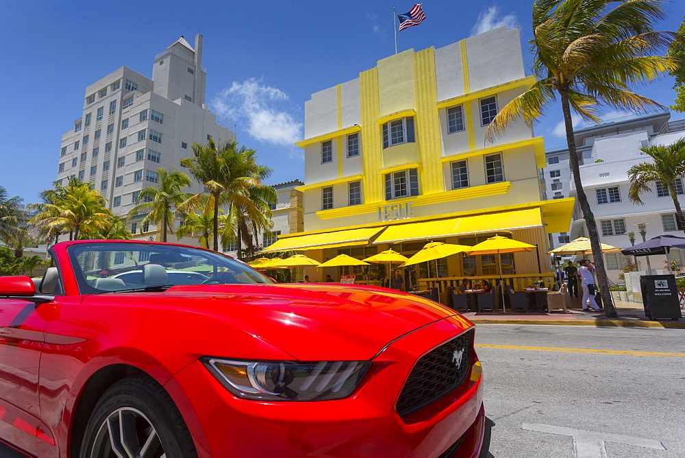 Art Deco architecture and red sports car on Ocean Drive, South Beach, Miami Beach, Miami, Florida, United States of America, North America