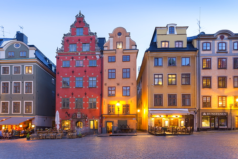 View of colourful buildings on Stortorget, Old Town Square in Gamla Stan at dusk, Stockholm, Sweden, Scandinavia, Europe