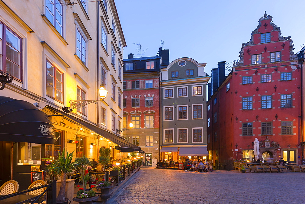 Restaurant and colourful buildings on Stortorget, Old Town Square in Gamla Stan at dusk, Stockholm, Sweden, Scandinavia, Europe - 844-13412