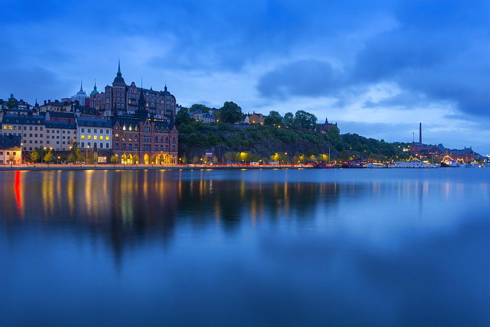 Skyline of Sodermalm at dusk reflection in water, Stockholm, Sweden, Scandinavia, Europe