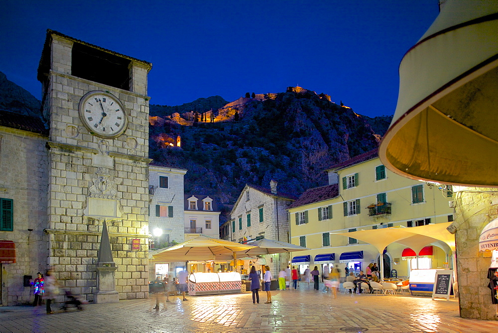 Old Town Clock Tower and Fort at dusk, Old Town, UNESCO World Heritage Site, Kotor, Montenegro, Europe