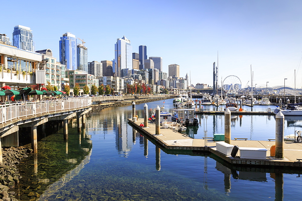 Seattle Skyline and restaurants on sunny day in Bell Harbour Marina. Seattle, Washington, USA, North America