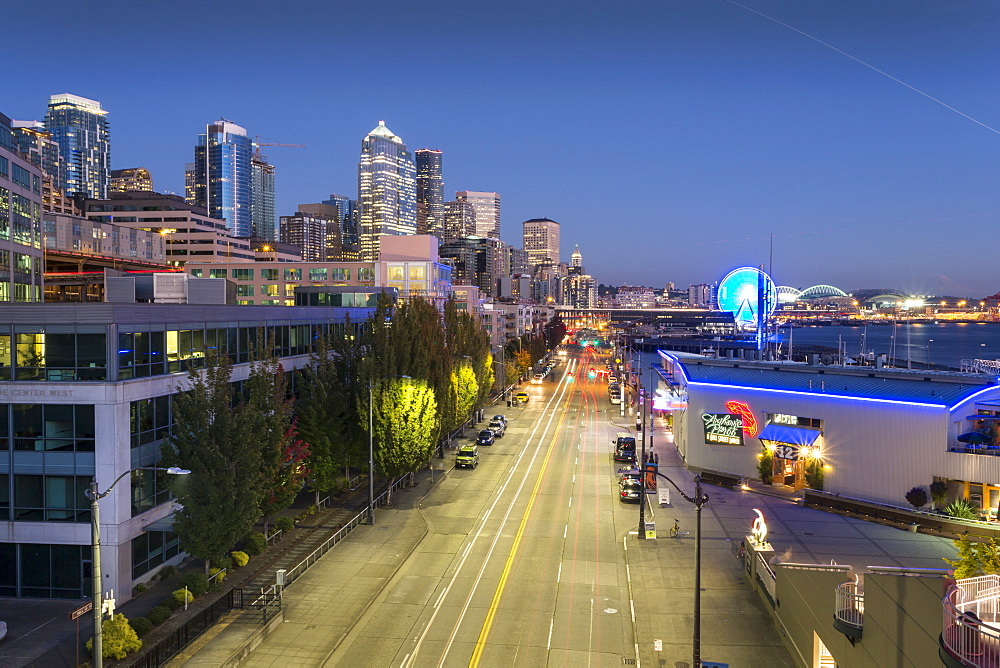 Elevated view of Seattle skyline and traffic on Alaskan Way at dusk, Belltown District, Seattle, Washington State, United States of America, North America