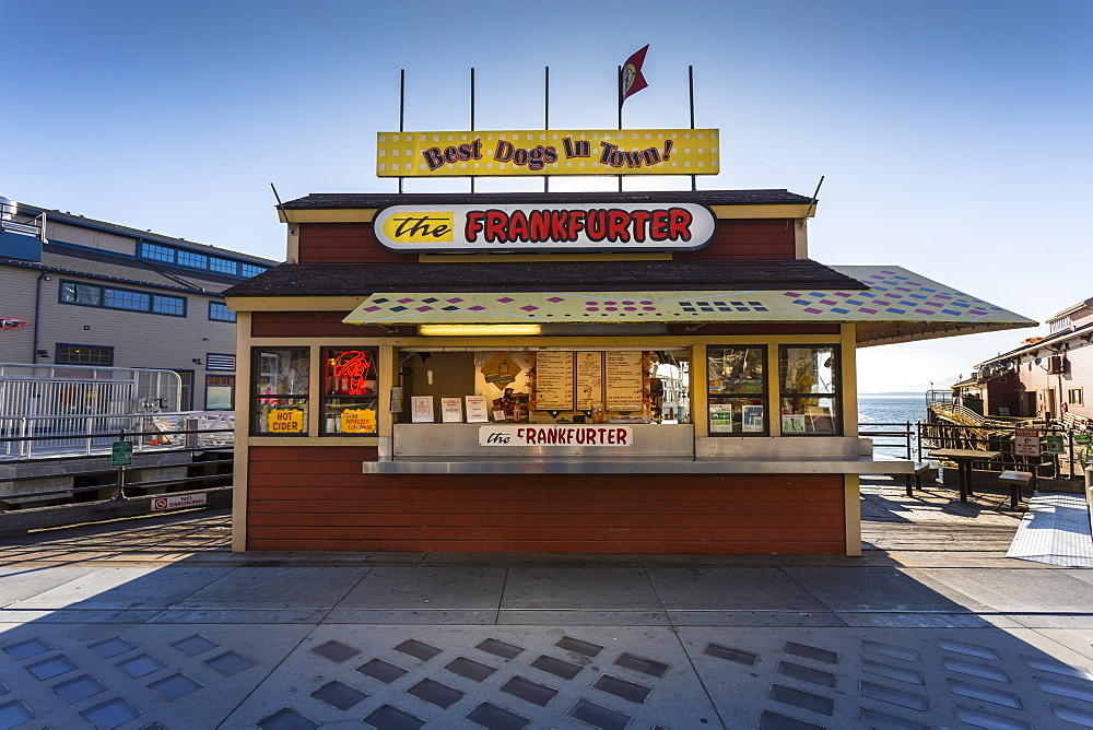 Backlit Frankfurter stall next to Pier 54 in late afternoon, Alaskan Way, Downtown, Seattle, Washington, USA, North America