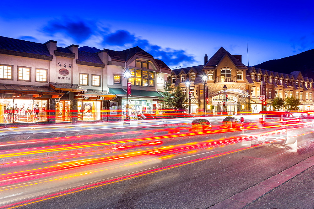 Trail lights and shops on Banff Avenue at dusk, Banff, Banff National Park, Alberta, Canada, North America - 844-14394