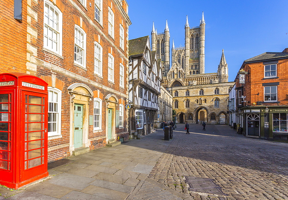 Lincoln Cathedral viewed from Exchequer Gate with red telephone visible, Lincoln, Lincolnshire, England, UK, Europe