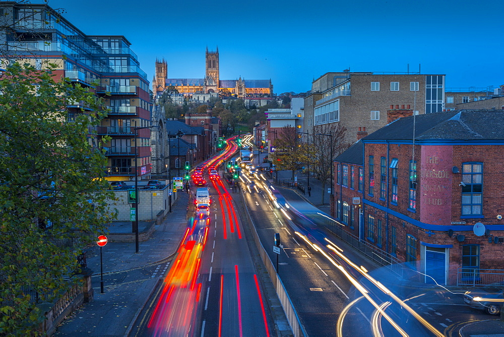 View of Lincoln Cathedral and traffic on Broadgate at dusk, Lincoln, Lincolnshire, England, UK, Europe - 844-14472