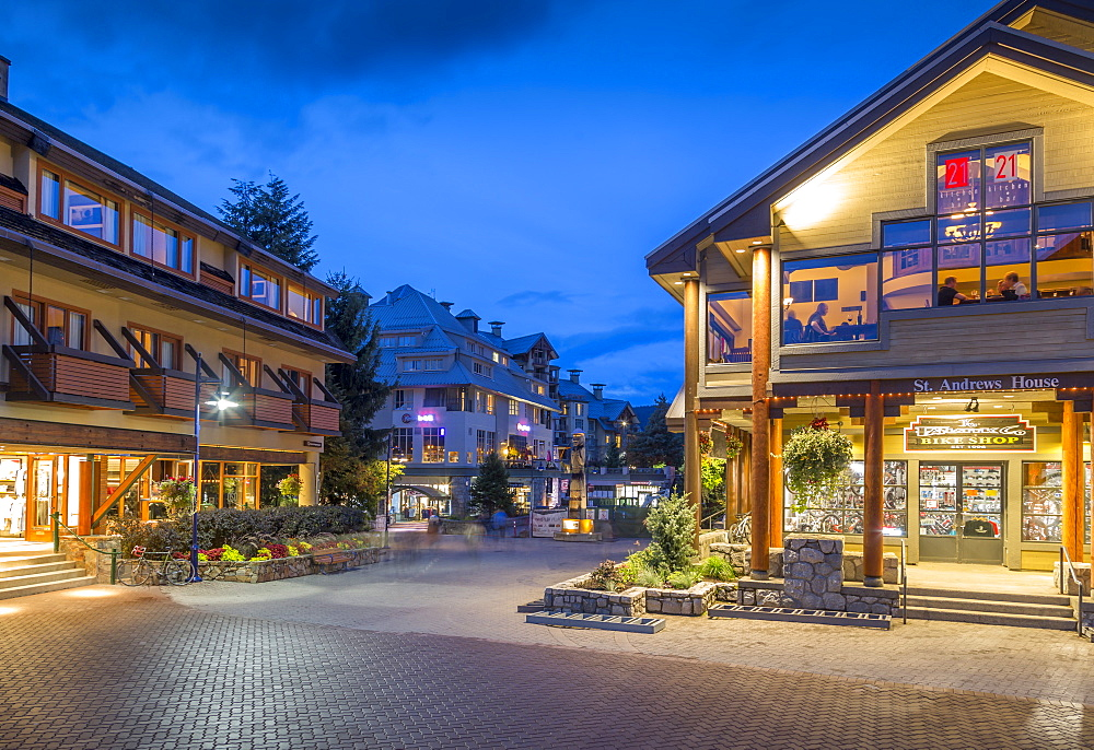 Illuminated bar on Village Stroll at dusk, Whistler, British Columbia, Canada, North America