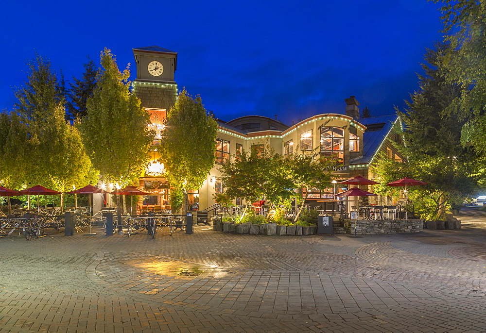 Illuminated shops on Village Stroll at dusk, Whistler, British Columbia, Canada, North America