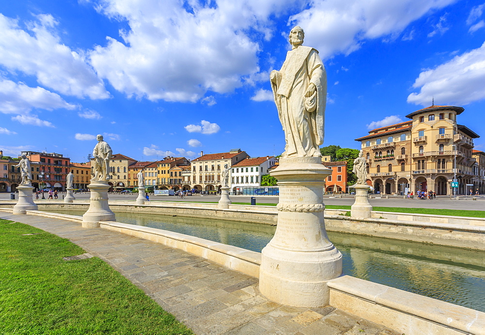 View of statues in Prato della Valle and colourful architecture visible in background, Padua, Veneto, Italy