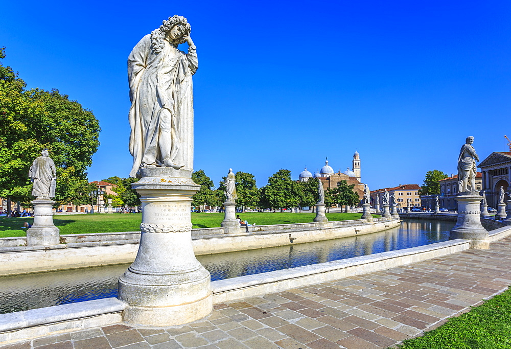View of statues in Prato della Valle and Santa Giustina Basilica visible in background, Padua, Veneto, Italy, Europe