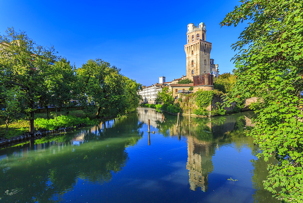 View of Museum Of The Astronomical Observatory Of Padua reflecting in river, Padua, Veneto, Italy, Europe