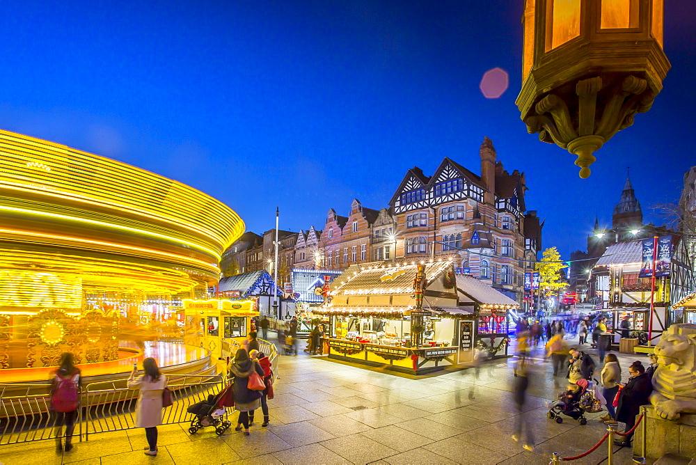 Christmas Market, Carousel and lamp on Old Market Square at dusk, Nottingham, Nottinghamshire, England, United Kingdom, Europe