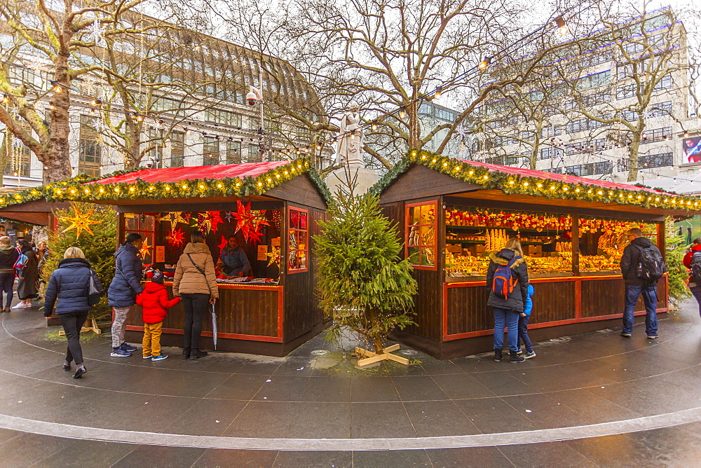 Christmas Market Stalls and William Shakespear Fountain in Leicester Square, London, England, UK, Europe