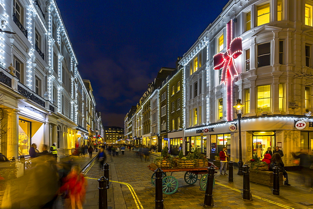 View of Christmas lights adorning Kings Street near Covent Garden at dusk, London, England, UK, Europe