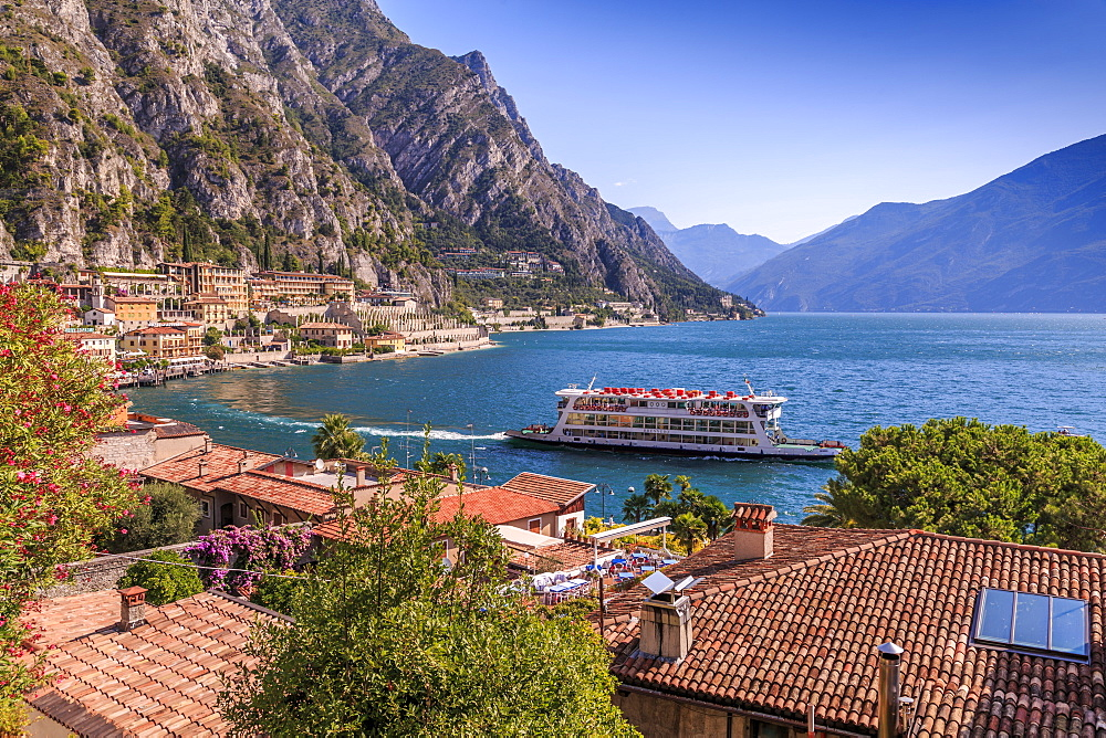 Elevated view of ferry on Lake Garda and rooftops in the port of Limone, Lake Garda, Lombardy, Italy, Europe