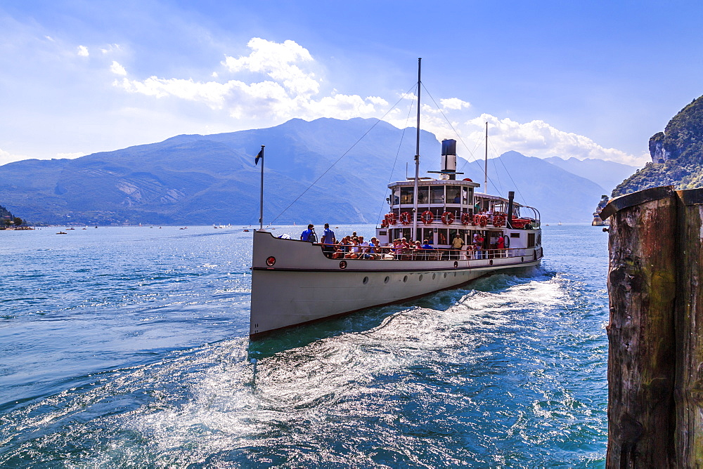 View of ferry boat leaving harbour at Riva del Garda, Riva del Garda, Lake Garda, Trentino, Italy, Europe