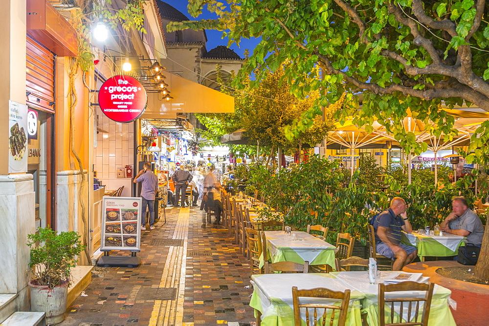 View of Greek restaurants in Monastiraki Square at dusk, Monastiraki District, Athens, Greece, Europe
