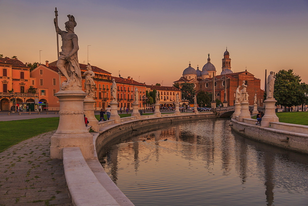View of statues in Prato della Valle at dusk and Santa Giustina Basilica visible in background, Padua, Veneto, Italy, Europe