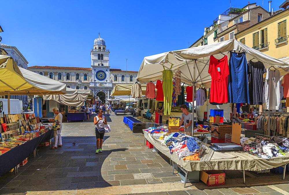 View of Torre Dell'Orologio and Market stalls in Piazza dei Signori, Padua, Veneto, Italy