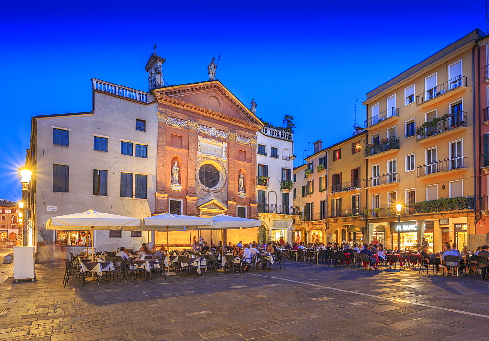 View of cafes and Chiesa di San Clemente in Piazza dei Signori at dusk, Padua, Veneto, Italy, Europe