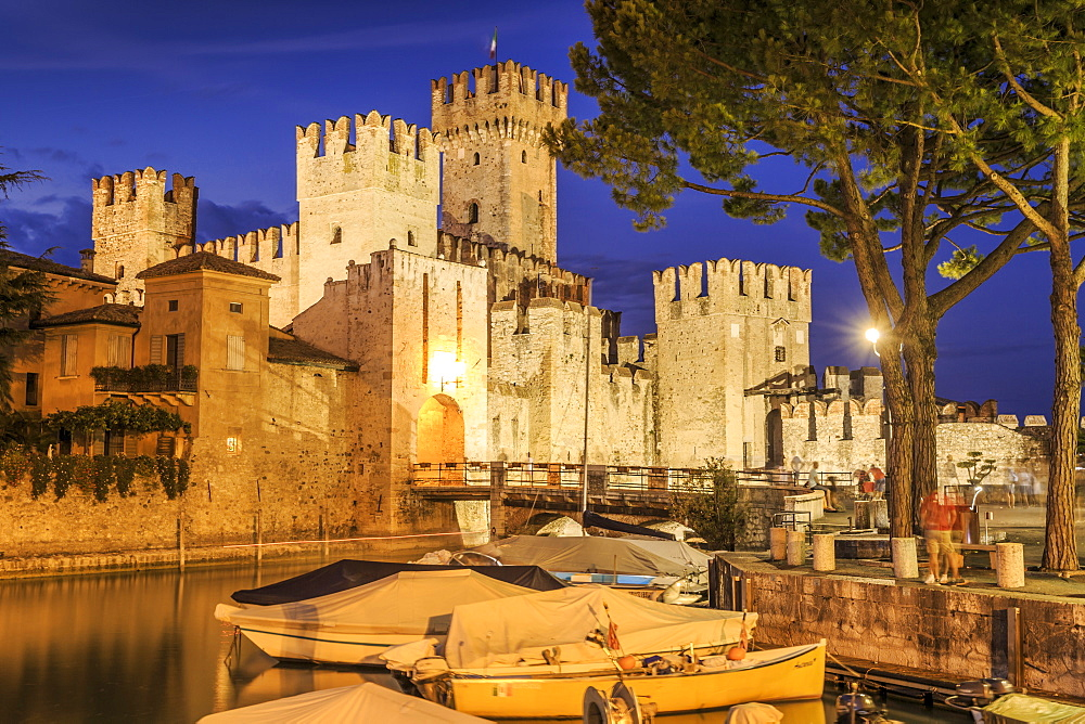 View of Scaliger Castle illuminated at night, Sirmione, Lake Garda, Lombardy, Italy, Europe