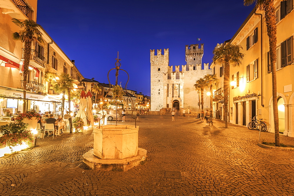 View of Scaliger Castle and Piazza Castello illuminated at night, Sirmione, Lake Garda, Lombardy, Italy, Europe