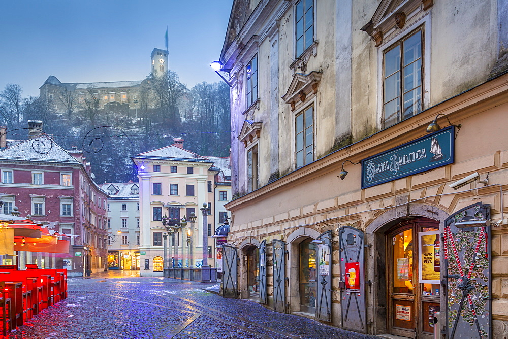 View from Old Town streets toward Ljubljana Castle at dusk, Ljubljana, Slovenia, Europe