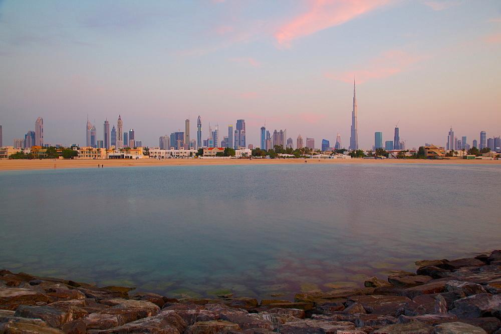 Burj Khalifa and city skyline at sunset, Jumeirah Beach, Dubai, United Arab Emirates, Middle East