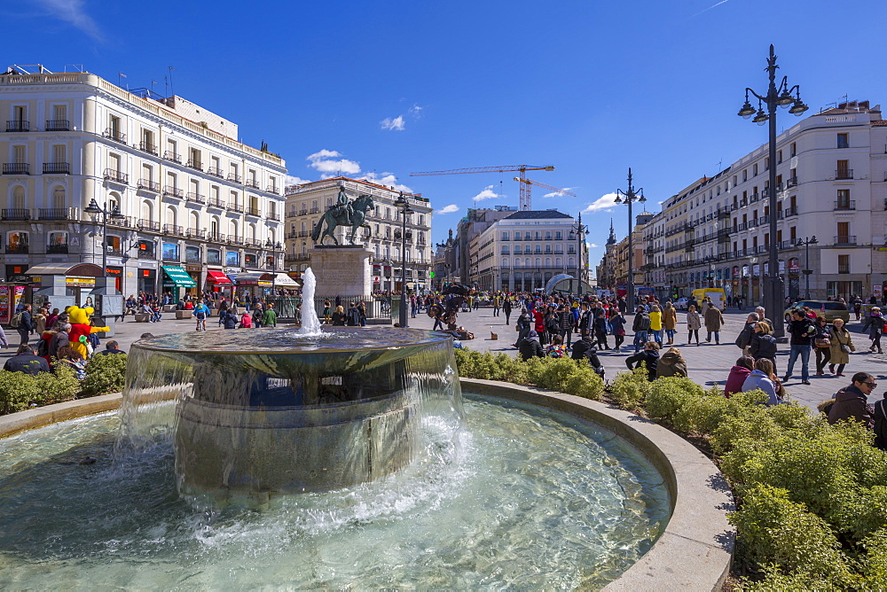 View of fountain and King Carlos lll statue in Puerta del Sol, Madrid, Spain, Europe