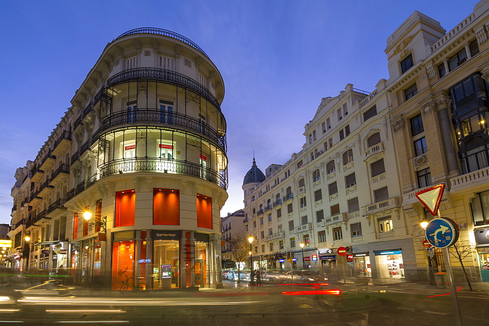 View of architecture on and around Calle Mayor and Calle Postas at dusk, Madrid, Spain, Europe