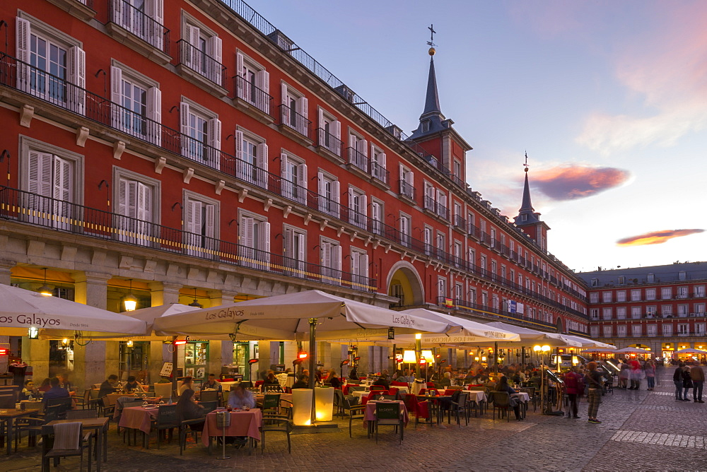 View of restaurants in Plaza Mayor at dusk, Madrid, Spain, Europe