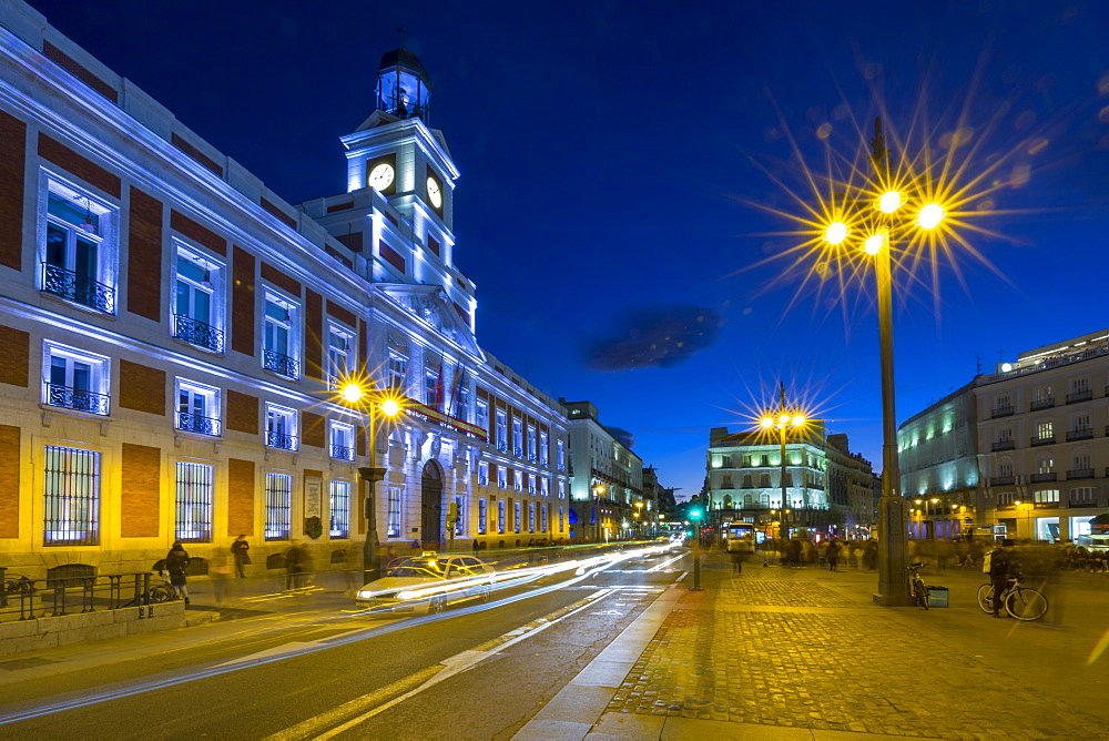 Trail lights and Real Casa de Correos at Puerta del Sol at dusk, Madrid, Spain, Europe