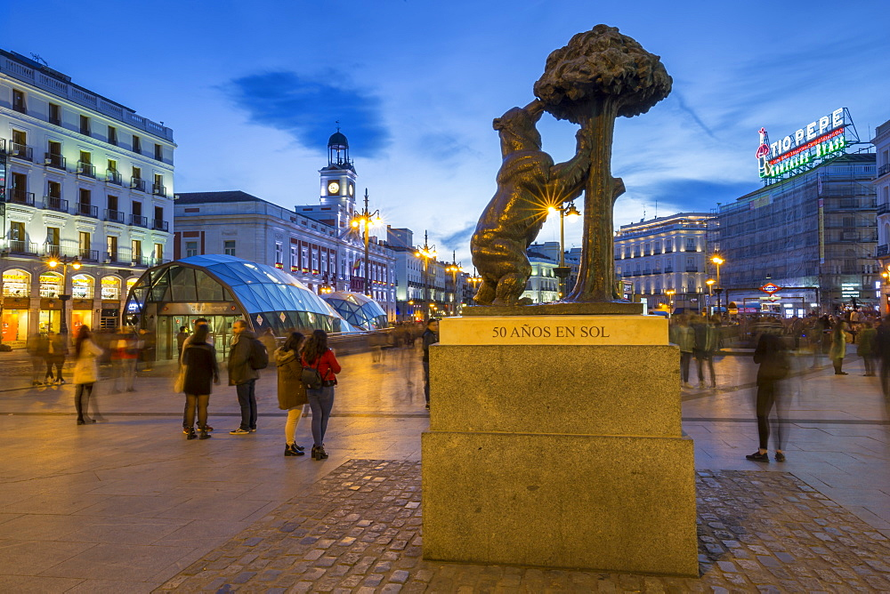 View of Bear and Strawberry Tree statue and Puerta Del Soll at dusk, Madrid, Spain, Europe