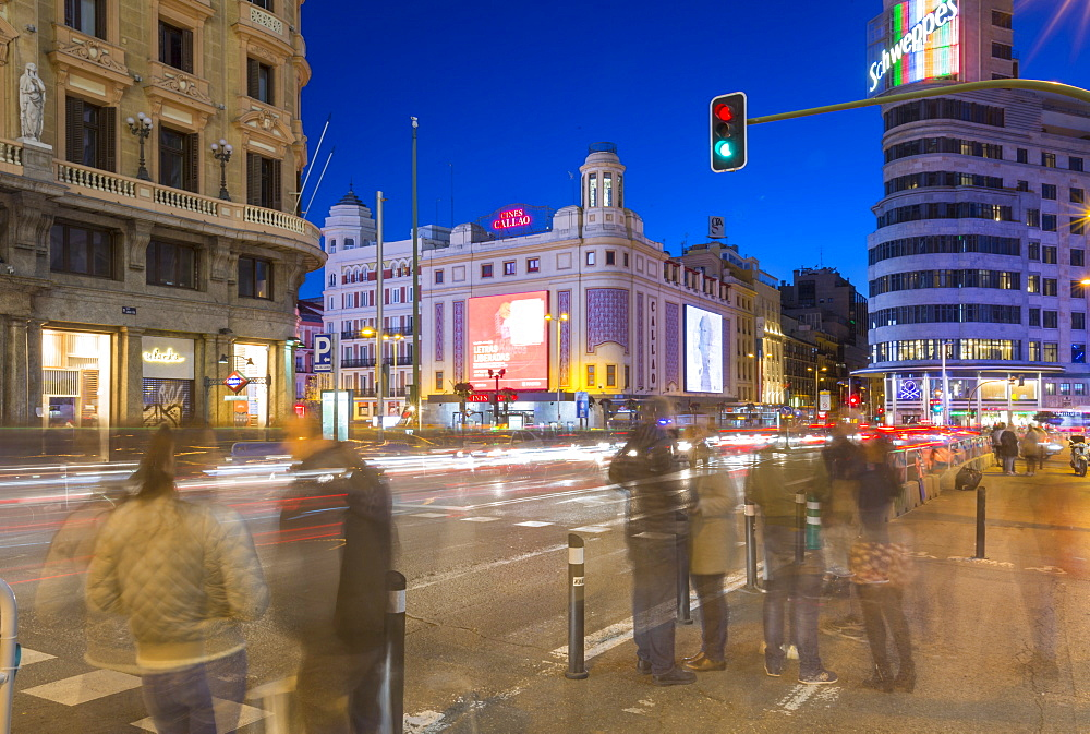 View of architecture and trail lights on Gran Via and Plaza del Calao at dusk, Madrid, Spain, Europe