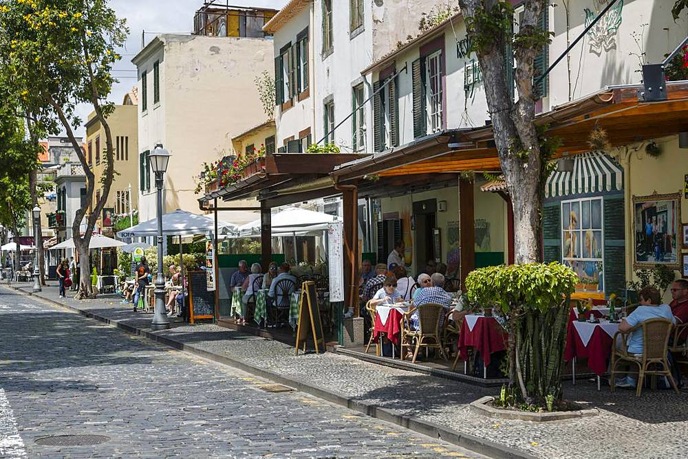 View of cafes and restaurants on old town street, Funchal, Madeira, Portugal, Atlantic, Europe