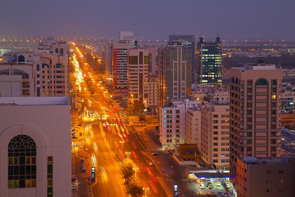 City skyline and Rashid Bin Saeed Al Maktoum Street at dusk, Abu Dhabi, United Arab Emirates, Middle East