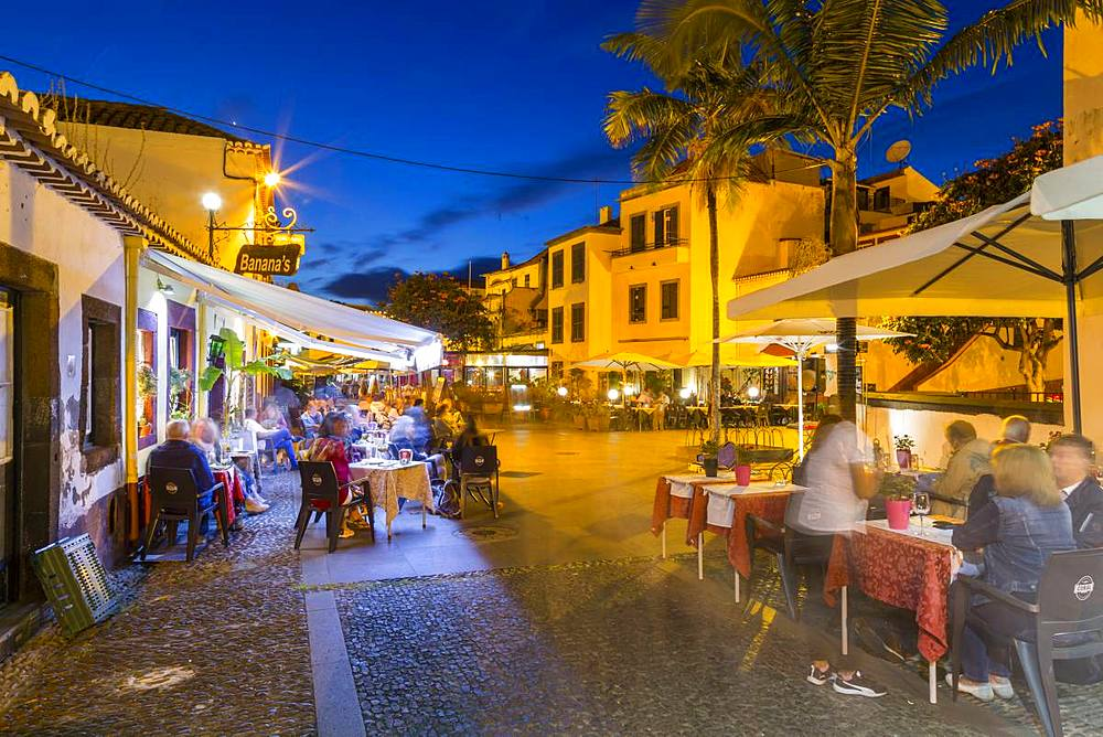 View of cafe in cobbled street in old town at dusk, Funchal, Madeira, Portugal, Europe - 844-16299