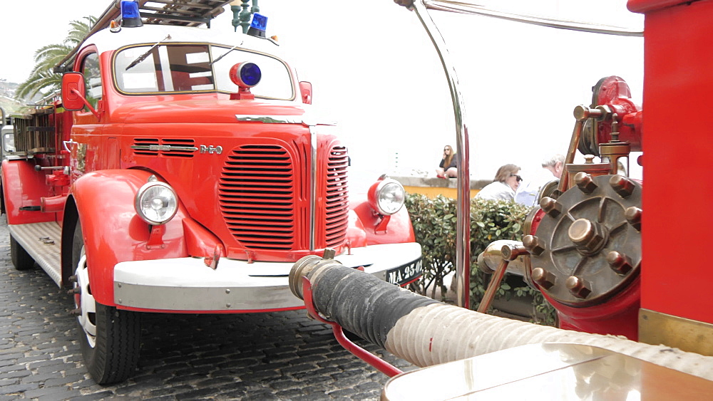 Roaming shot of vintage fire engines at spring festival, Funchal, Madeira, Portugal, Europe