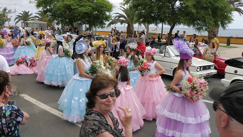 Roaming shot of pastel coloured flower girls parade at spring festival, Funchal, Madeira, Portugal, Europe