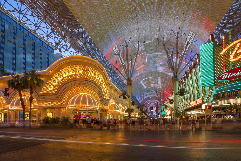 Golden Nugget Casino and neon lights on the Fremont Street Experience at dusk, Downtown, Las Vegas, Nevada, USA, North America