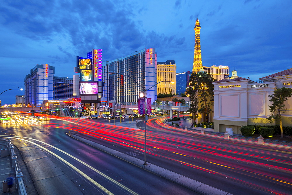 View of the Paris Eiffel Tower and Ballys Hotel and Casino at dusk, The Strip, Las Vegas Boulevard, Las Vegas, Nevada, United States of America, North America