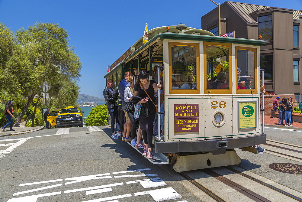 View of Hyde Street cable car and Alcatraz in backgound, San Francisco, California, USA, North America
