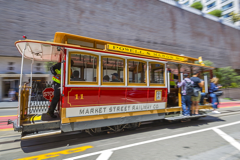 Fast moving cable car on Powel Street, San Francisco, California, United States of America, North America