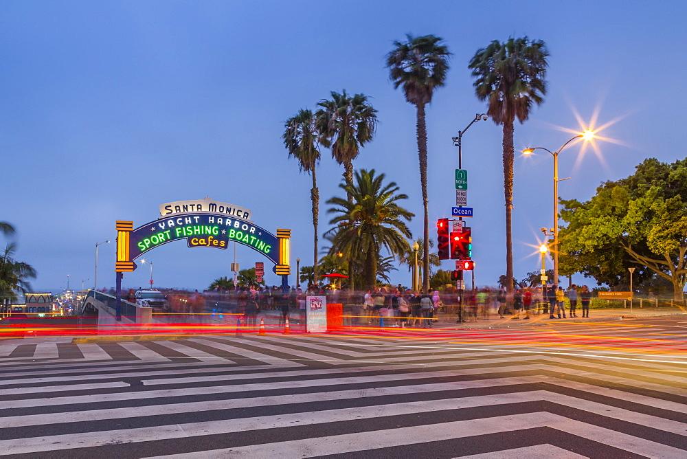 Entrance to Santa Monica Pier at dusk, Santa Monica, Los Angeles, California, United States of America, North America