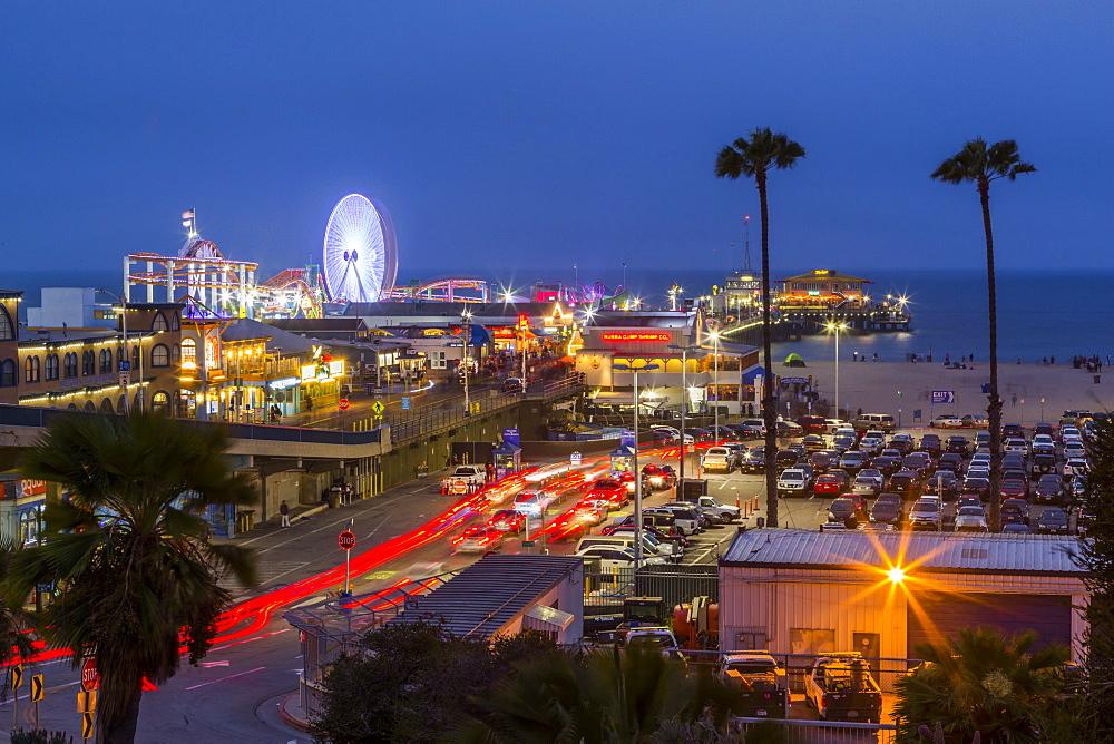View of Santa Monica Pier at dusk, Santa Monica, Los Angeles, California, United States of America, North America